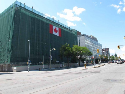 Looking north at west side of Elgin Street with Lorne Building demolition in foreground and British High Commission beyond