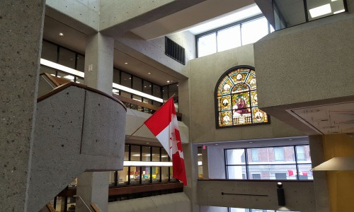 The atrium from the stair highlighting a stained glass window retained from the previous Carnegie Library