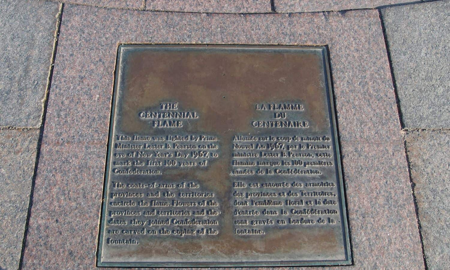 Plaque identifying the monument embedded in the pavers