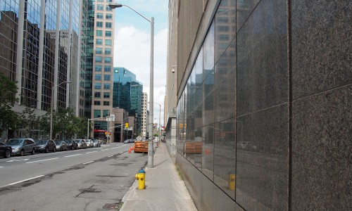 Continuous polished granite along the sidewalk edge