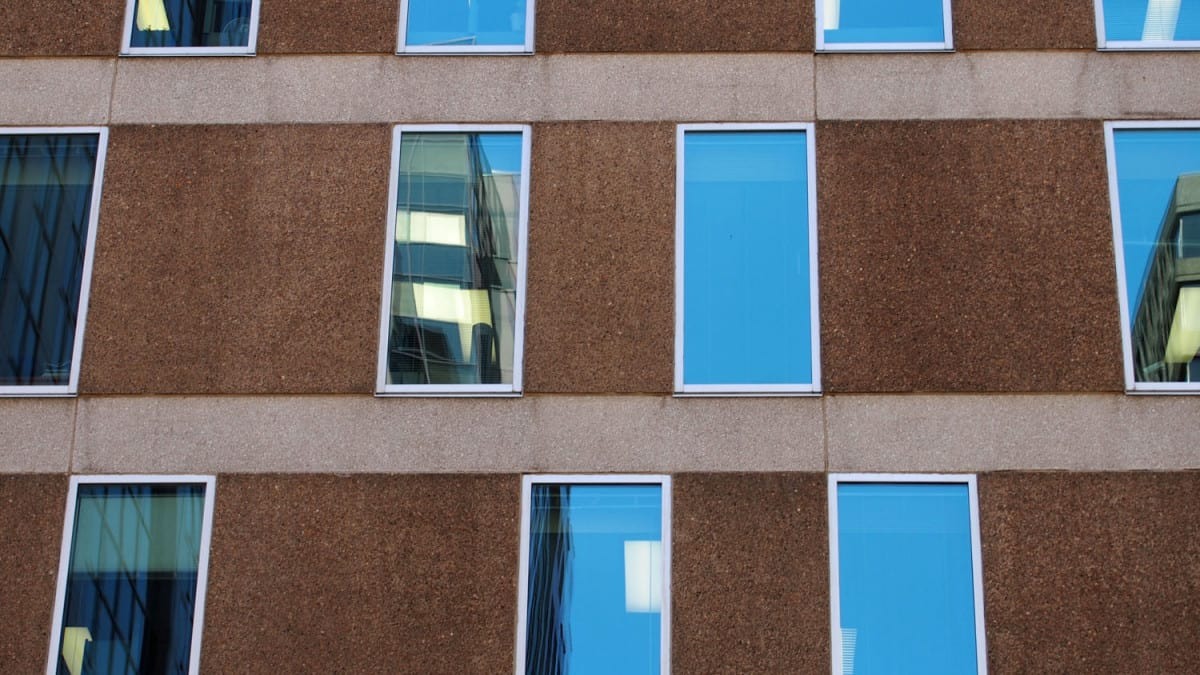Windows within the elevations are randomly placed within a grid, but always related to the floors above and below