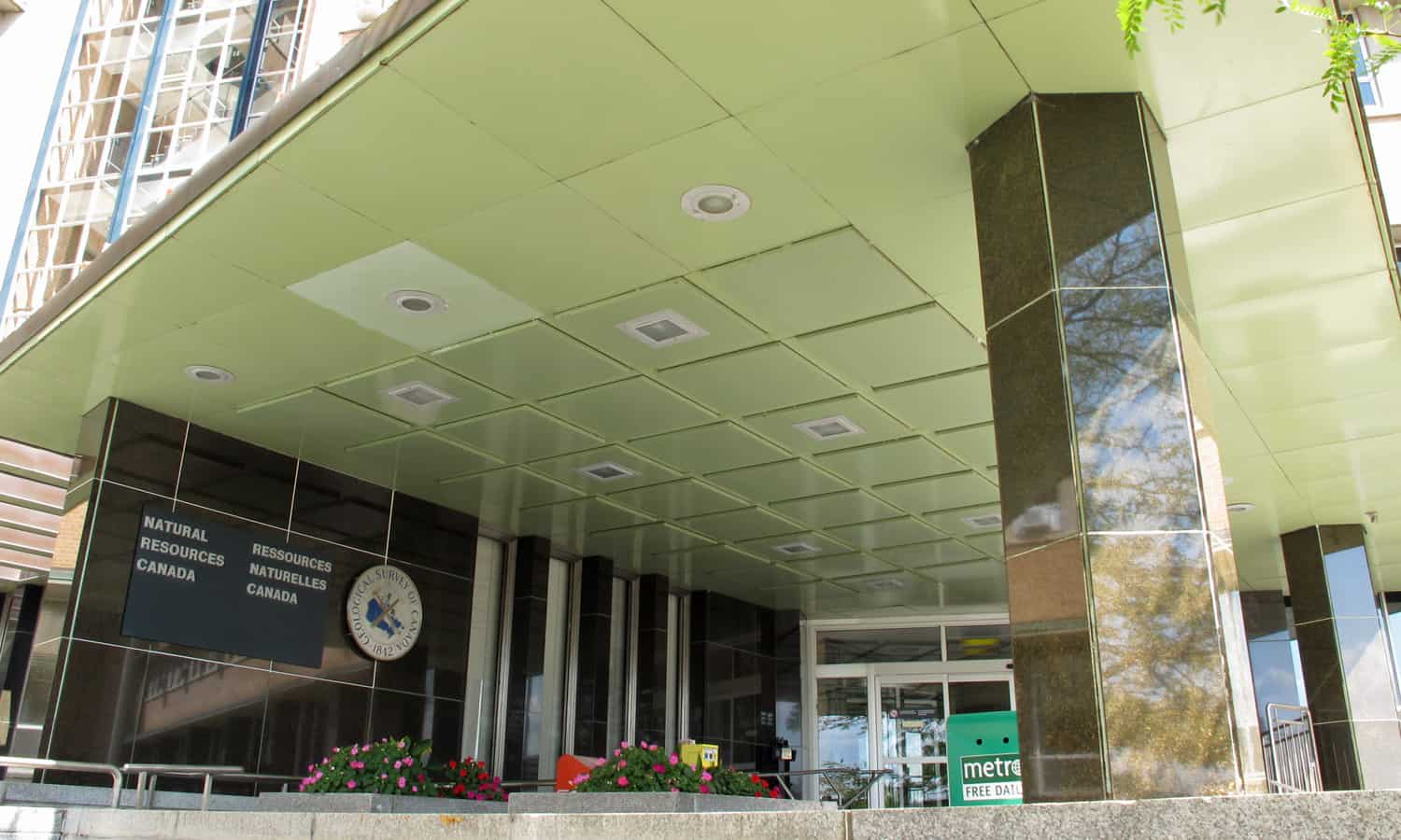 Detail of the entry canopy and main entrance located at the intersection between the two primary wings of the building