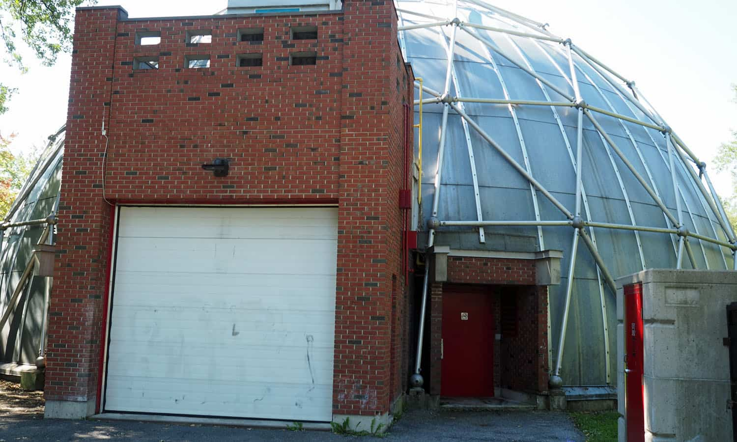 Zamboni storage at the northeast of the building finished in contrasting burnt red brick