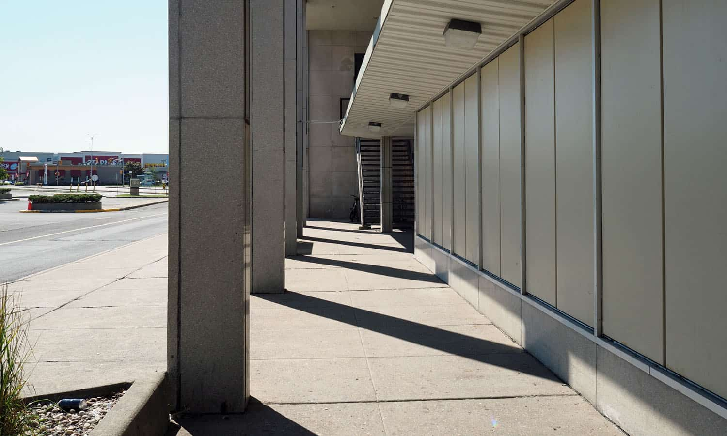 Shadow play under the double-height east colonnade